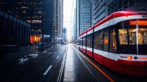 Превью обои улица, город, трамвай, здания, дождь