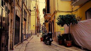 Превью обои улица, мотоцикл, тротуар, здания, архитектура