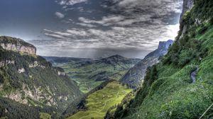 Превью обои ущелье, вид, горы, скалы, облака
