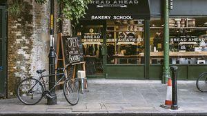 Превью обои велосипед, улица, магазин, город