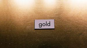 Превью обои золото, слово, надпись, поверхность, текстура