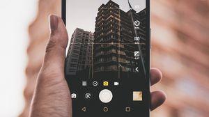 Превью обои телефон, рука, здание, фото