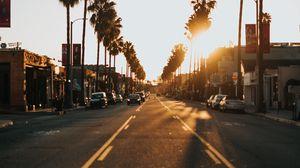 Превью обои улица, город, закат, пальмы, машины