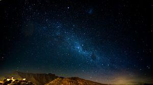 Превью обои звездное небо, ночь, горы, сияние, блеск